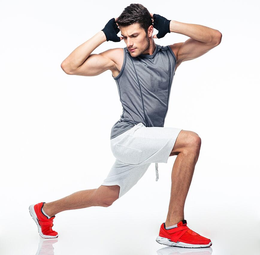 Full length portrait of a fitness man stretching isolated on a white background.jpeg