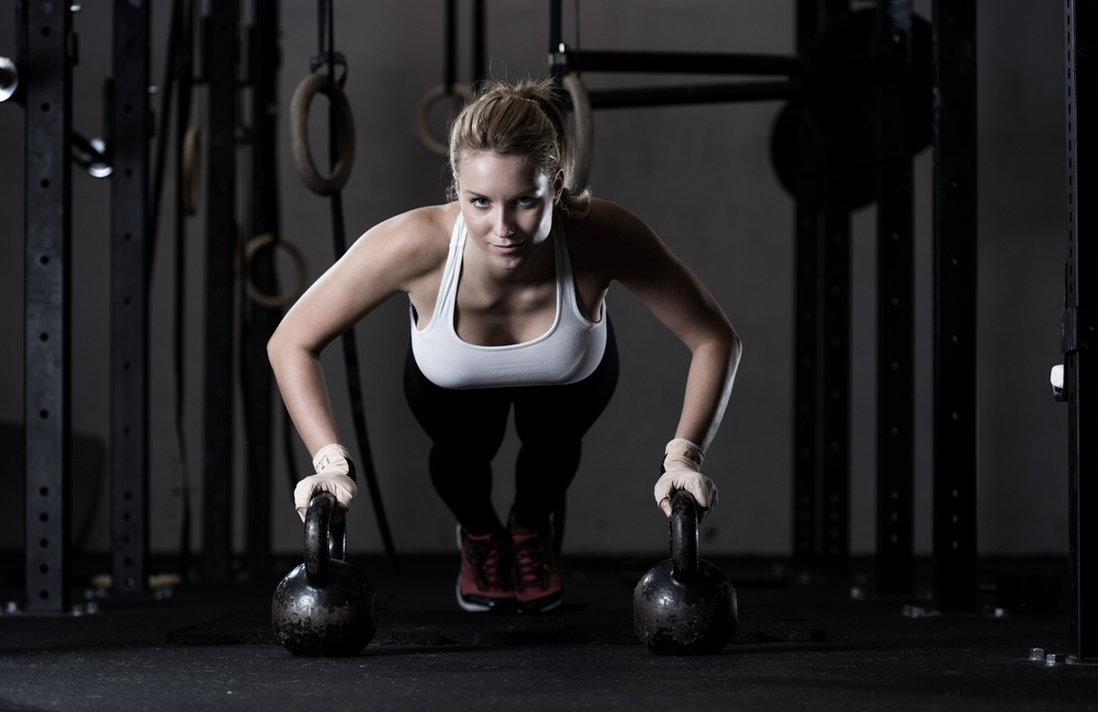 Which kettlebell should a woman start with