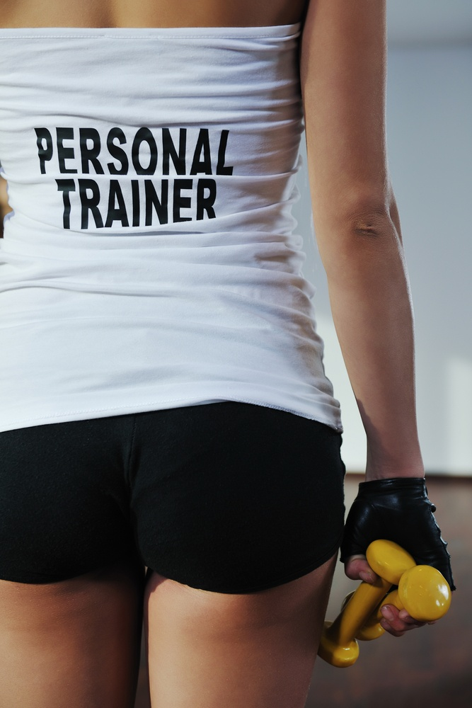 fitness woman personal trainer in sport club indoor.jpeg