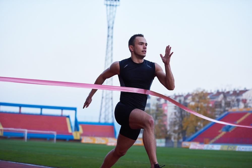 athletic runner finish line track